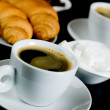 Cup of black coffee with croissants — Stock Photo #1808033