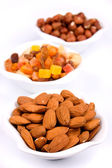 Almonds and other healthy snacks — Stock Photo