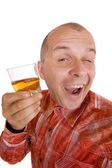 Drunk man holding a glass of whisky — Stock Photo