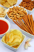 Potato chips and other salty snacks — Stock Photo