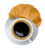 Croissant and cup of coffee — Stock Photo