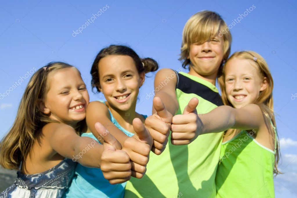 Four young beautiful kids showing thumbs up   Stock Photo #1807368
