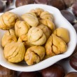 Peeled chestnut in a bowl - Stock Photo