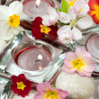Flowers, candles and stones - Stock Photo