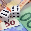 Dices thrown on euro money — Stock Photo
