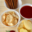 Salty snacks and salsa dip — Stock Photo