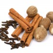 Nutmeg, cinnamon sticks and cloves - Stock Photo