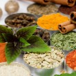 Basil leafs over assortment of spices - Stockfoto