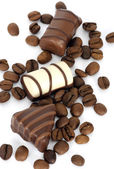 Coffe beans and chocolate candies — Stock Photo
