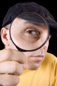 Detective with magnifier — Stock Photo