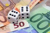 Dices thrown on euro money — Stock Photo