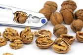 Walnuts and nutcracker — Stock Photo
