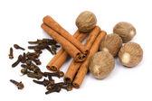 Nutmeg, cinnamon sticks and cloves — Stock Photo