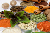 Basil leafs over assortment of spices — Stock Photo