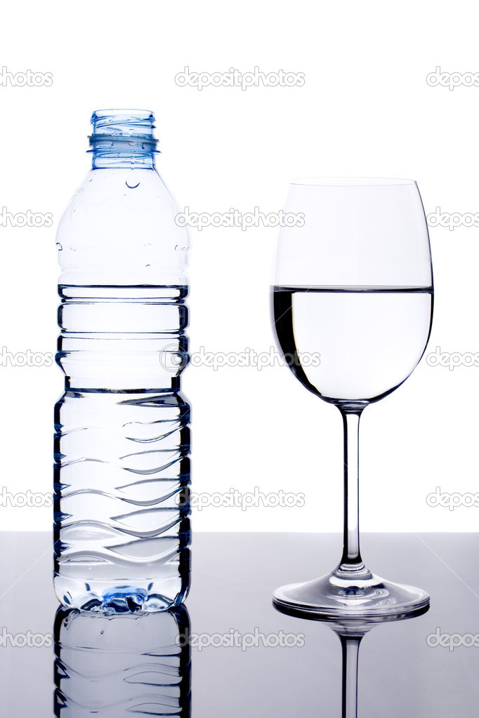 Glass and bottle with water on white background — Stock Photo #2066449