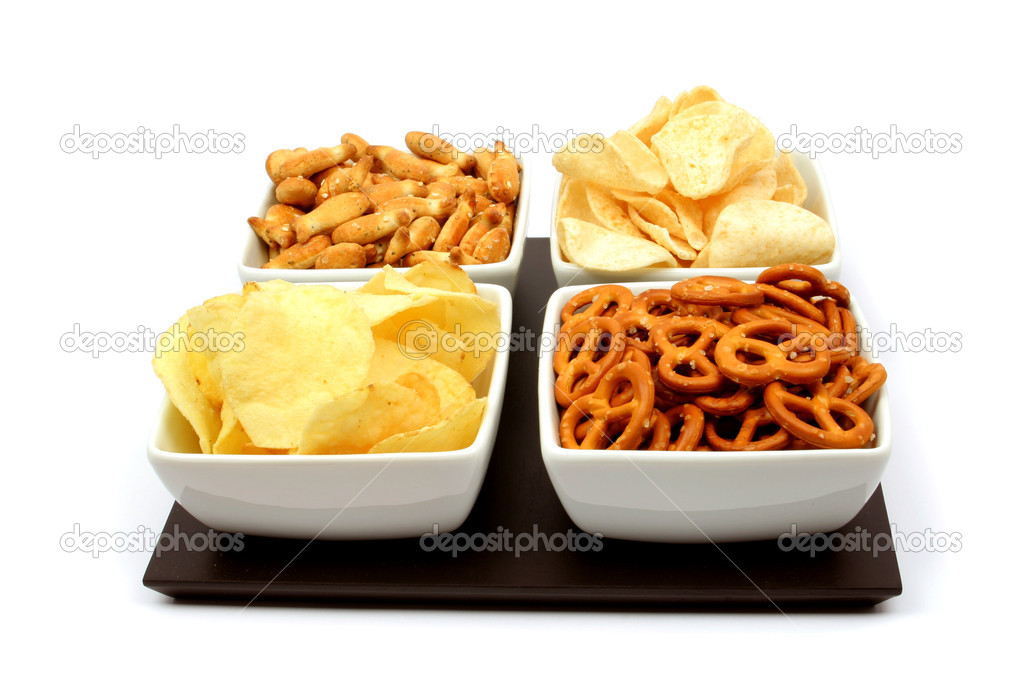 Potato chips and other salty snacks in square bowls isolated on white — Stock Photo #2066901