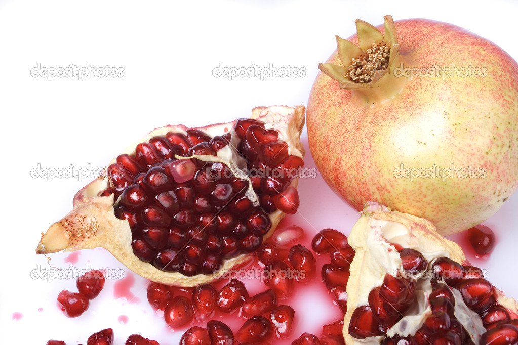 Ripe pomegranate fruit isolated on white background  Stock Photo #2067879