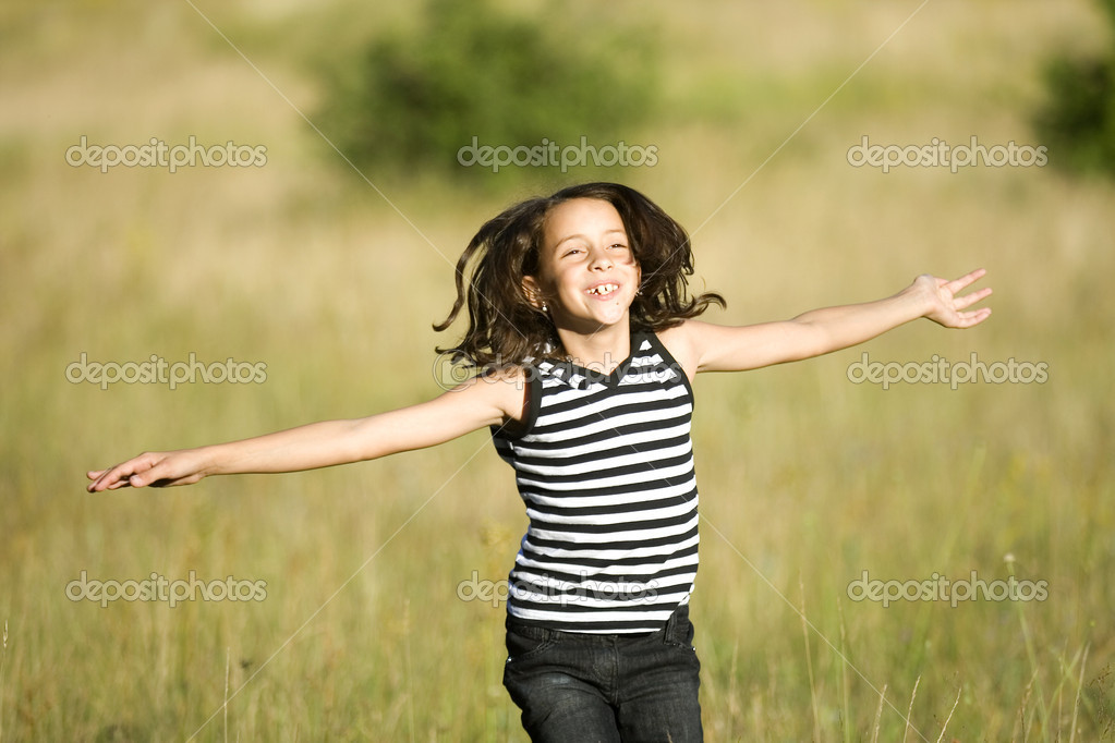 Young girl having fun in fields on a sunny summer day — Stock Photo #2068244