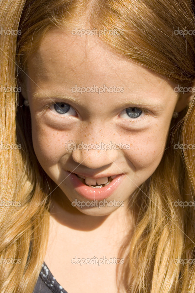 Portrait of a beautiful young redhead girl — Stock Photo #2068273