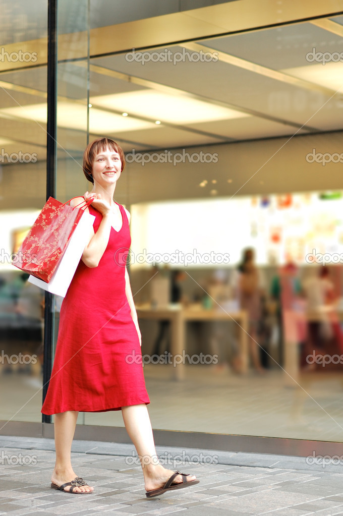 Beautiful young woman spend the time in shopping — Stock Photo #1817806