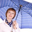 Girl with an umbrella. - Stock Photo