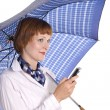 Stock Photo: Girl with mobile phone and umbrella.