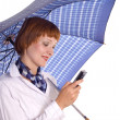 Royalty-Free Stock Photo: Girl with mobile phone and an umbrella.