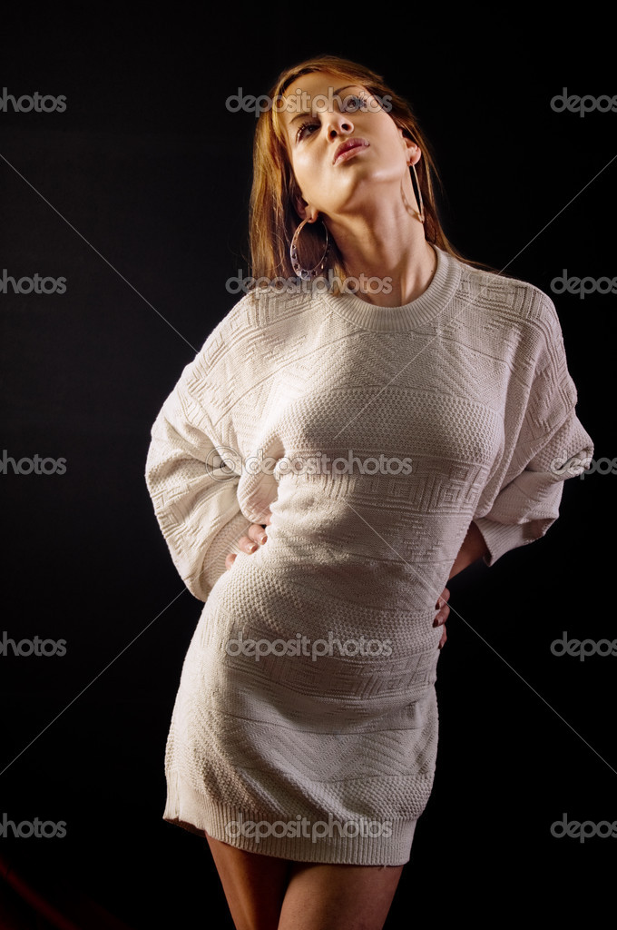 Pretty young adult woman posing in white sweater — Stock Photo #1734662