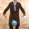 Businessman and globe — Stock Photo #1818130