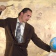 Businessman with globe — Stock Photo #1818398