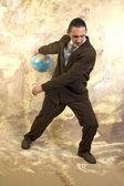 Businessman and globe — Stock Photo