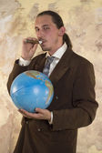 Businessman and globe — Stock Photo