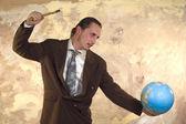 Businessman with globe — Stockfoto