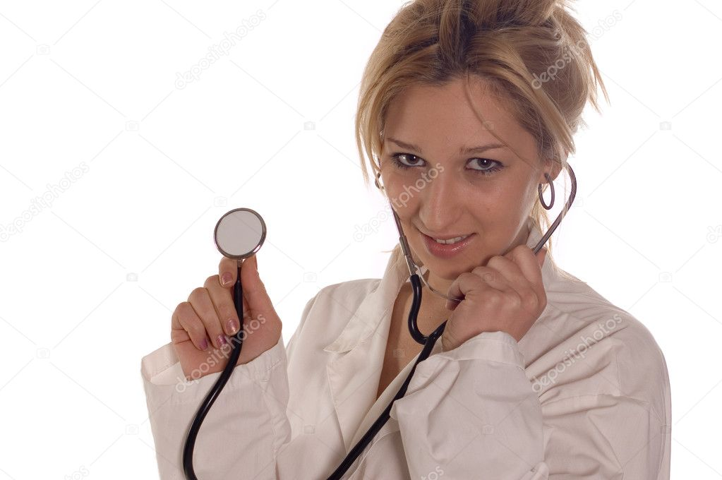 Doctor in hospital with stethoscope on white — Stock Photo #1810197
