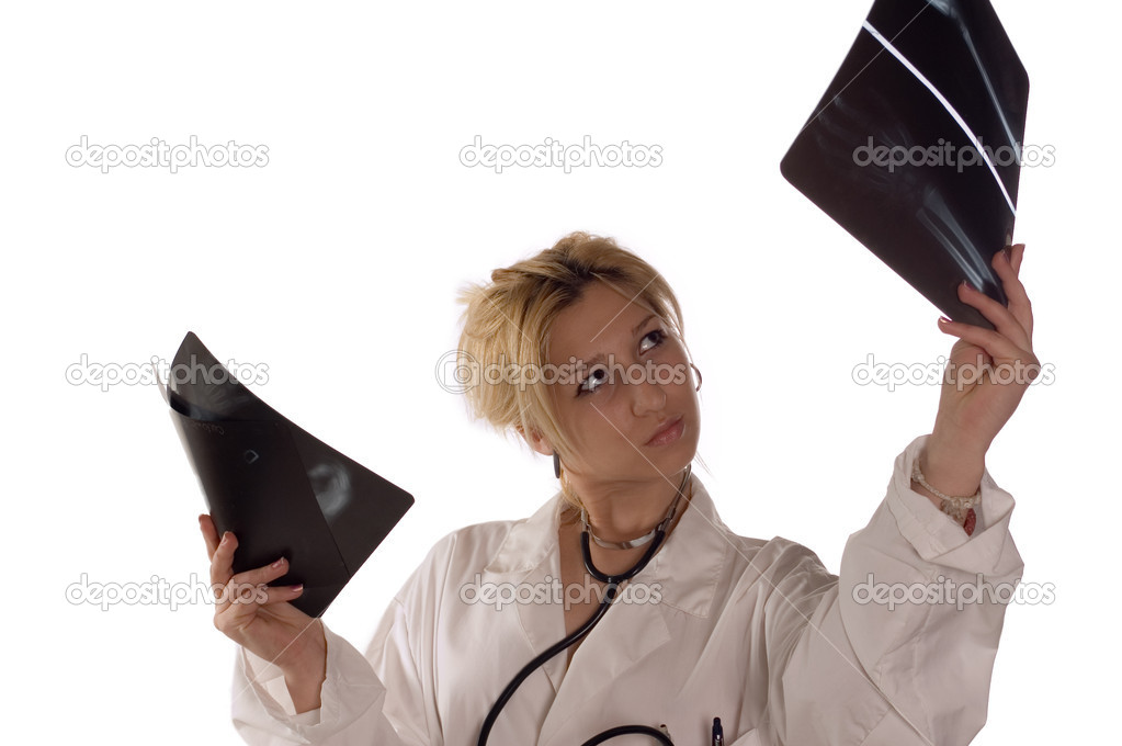 Doctor with stethoscope examine x-ray on white — Stock Photo #1810306