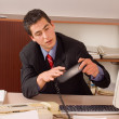 Foto Stock: Businessman at office