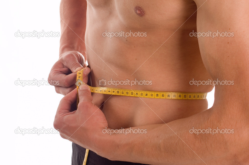 Young pretty man measuring his perfect body isolated on white — Stock Photo #1832348