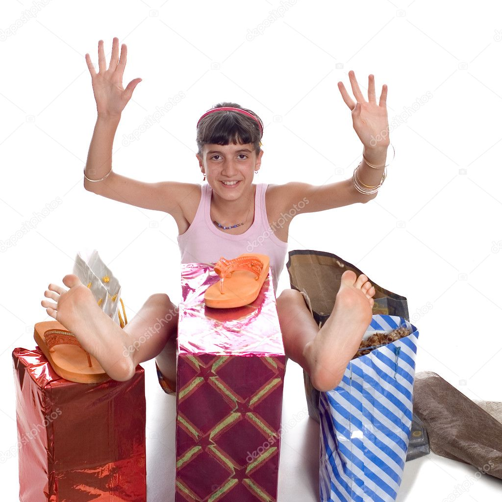 Glad young child with gifts after shopping — Stock Photo #1832588