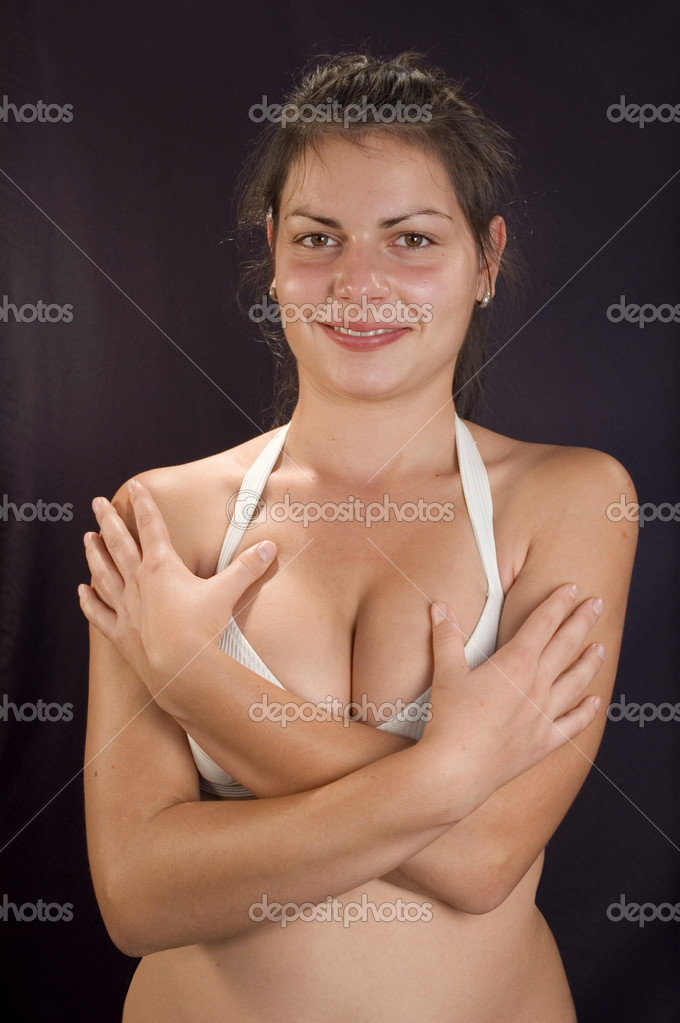 Young girl erotic pose on dark backgrounds