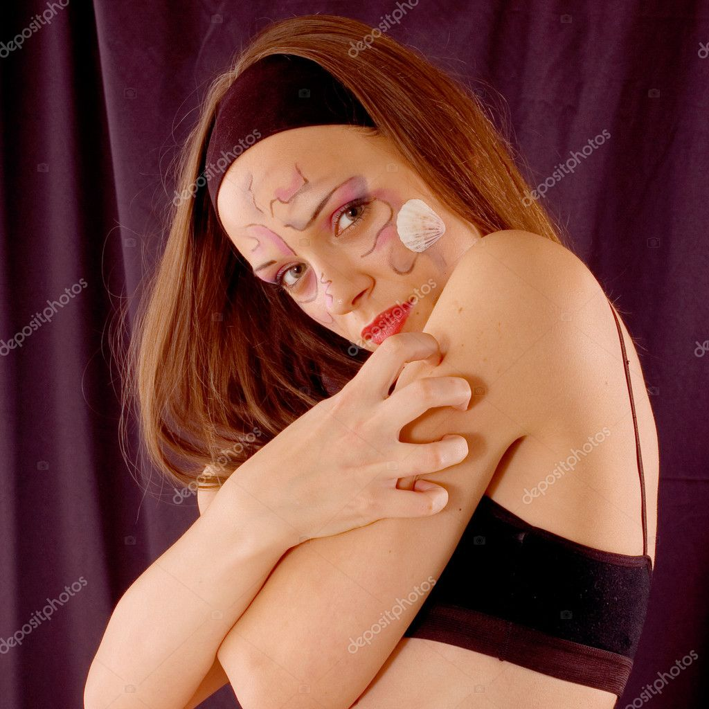 Portrait beautiful young woman with designe on face — Stock Photo #2192514