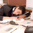 Businessman sleeping at office - Stock Photo
