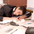图库照片: Businessmsleeping at office