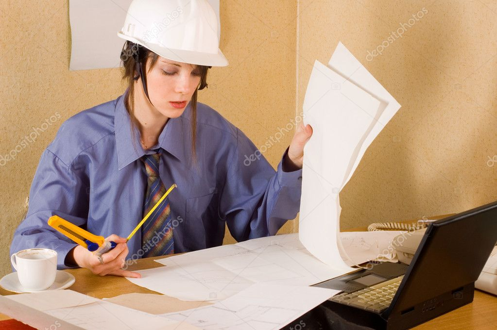 Woman architect with helmet on head and arch project at table — Stock Photo #2248552