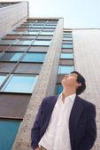 Budova a muž — Stock fotografie