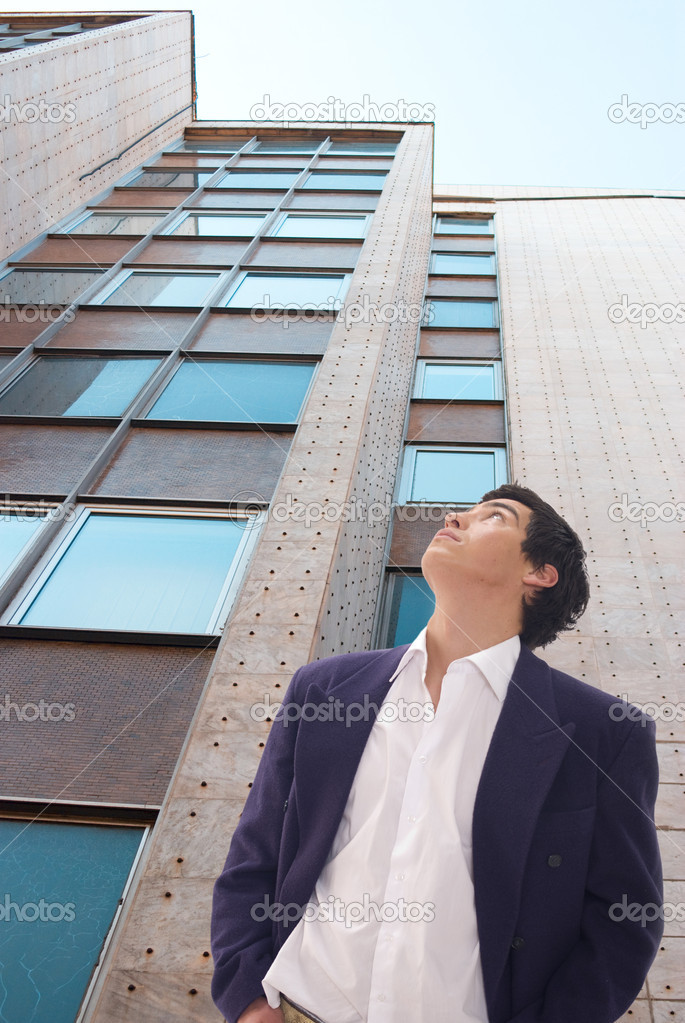 Tall building against blue sky and business man — Stock Photo #2305573