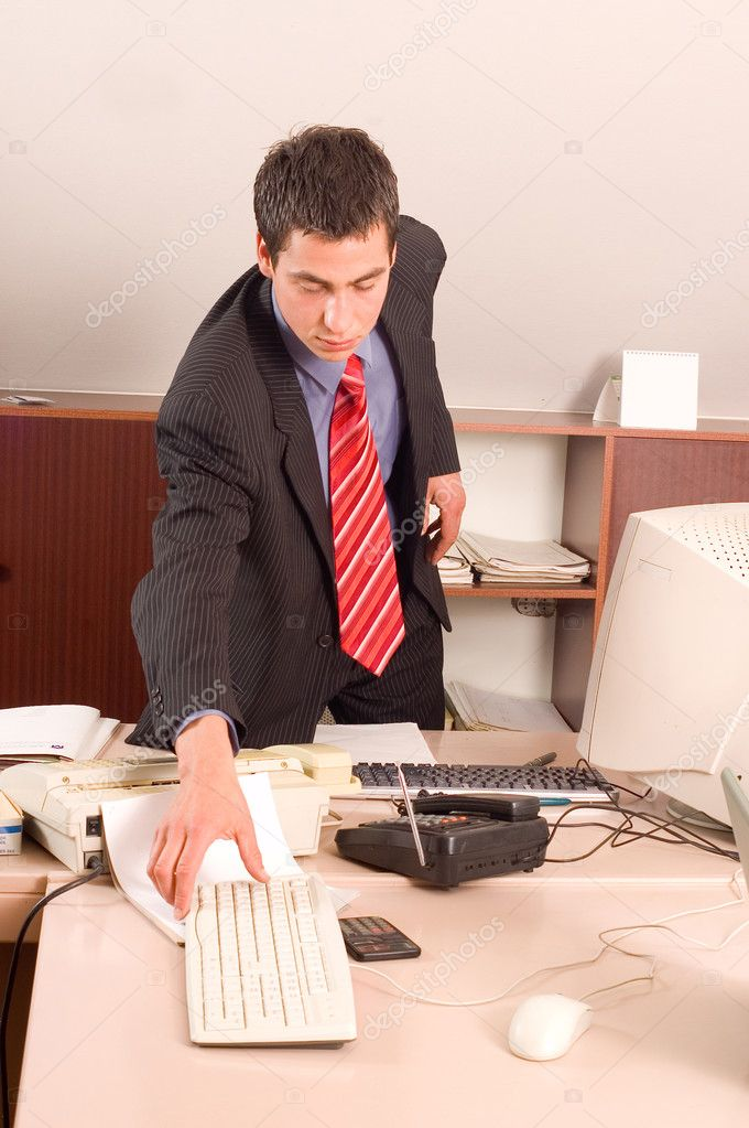 Businessman in his office at table working with computer  Stock Photo #2309614