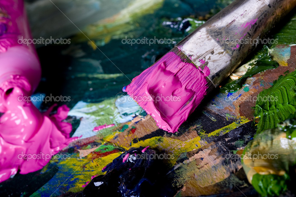 Artistic equipment: paint, brushes and knives on paint background — Stock Photo #2057711