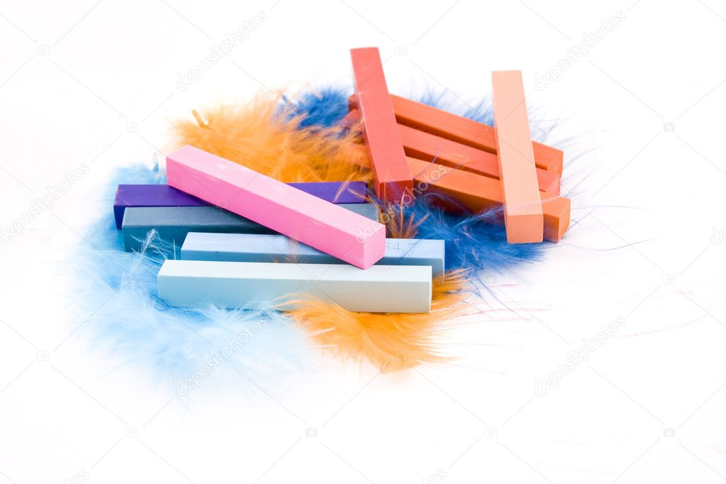 Blue, red and pink square pastel crayons on plumage background — Stock Photo #2154146