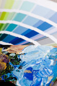 Color chart and artistic paint — Stock Photo