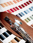 Artistic equipment and color chart — Stock Photo